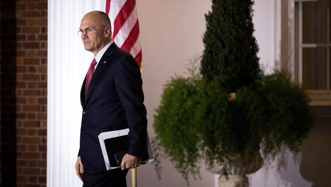 Andrew Puzder, chief executive of CKE Restaurants, exits after his meeting at Trump International Golf Club on Nov. 19, 2016 in Bedminster Township, N.J.