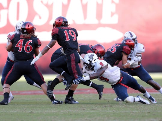 South Alabama defensive back Jeremy Reaves, a Catholic grad, makes one of his team-high 10 tackles last Saturday during the Jaguars' overtime win at San Diego State.