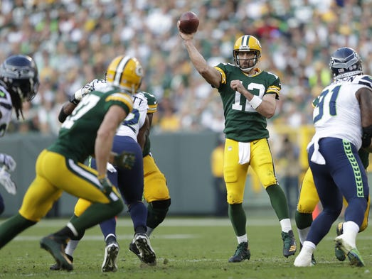Green Bay Packers' Aaron Rodgers (12) throws to Jordy