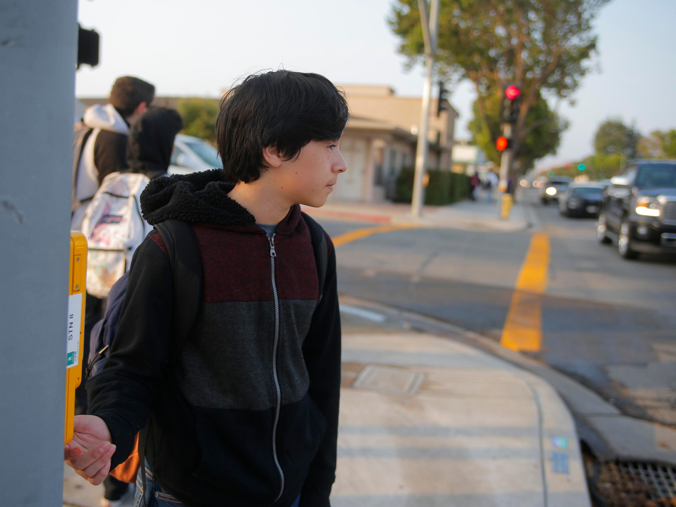 Jose Anzaldo crosses South Main Street on his way to Salinas High School where he's studying as a freshman this fall.