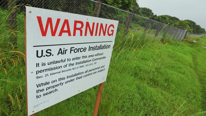 A sign posted along the perimeter of Andersen Air Force Base's Northwest Field is shown in this file photo.