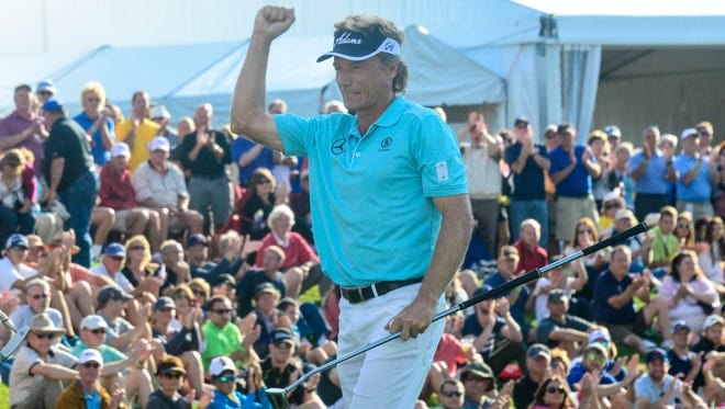 Bernard Langer raises his arm after winning the 2014 Dickâ?'s Sporting Goods Open on Sunday at En-Joie Golf Course in Endicott.