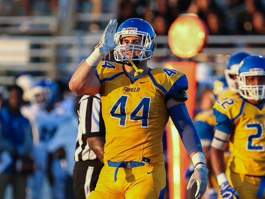 Tupelo's Jett Johnson (44) signals towards the sidelines