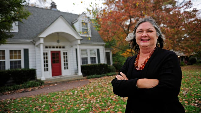 Real estate agent Sharon Kipp poses for a photograph in front of the Donelson home that her friend and client, Jennifer Spence, who lives out of state, rents via the HomeAway website.