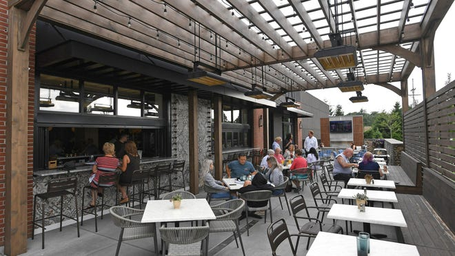 The outdoor patio at the Cork 1794 restaurant in the West Erie Plaza in Millcreek, shown in this July 2019 photo, is open for lunch and dinner daily.