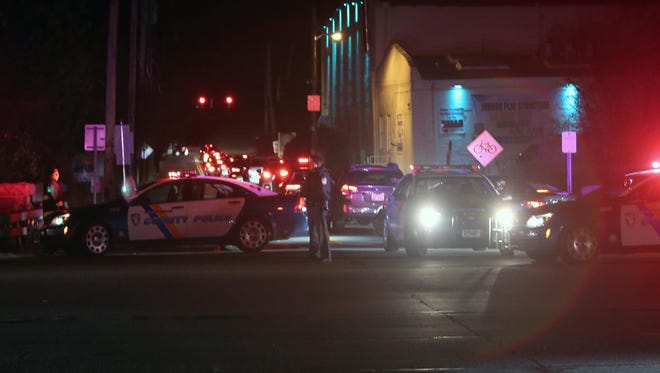 Westchester County police investigate a fatal car accident in which a pedestrian, Hever Latona, 42, of Elmsford, was struck by a car while crossing the Saw Mill River Parkway at Lawrence Street in Dobbs Ferry, Nov. 19, 2014.