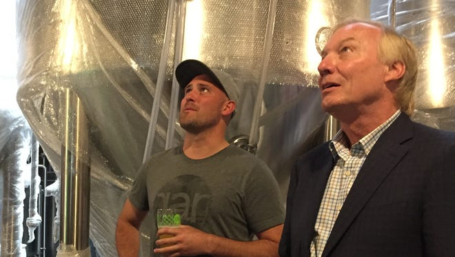 J.T. Merryweather, left, of RaR Brewing gives Maryland Comptroller Peter Franchot a tour of RaR in Cambridge, Maryland on Tuesday, June 27.