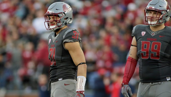 Washington State linebacker Isaac Dotson (left) has become an integral part of the Cougars' defense.