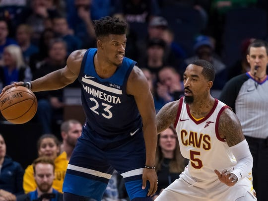 Jan 8, 2018; Minneapolis, MN, USA; Cleveland Cavaliers guard JR Smith (5) defends Minnesota Timberwolves forward Jimmy Butler (23) in the first quarter at Target Center. Mandatory Credit: Brad Rempel-USA TODAY Sports