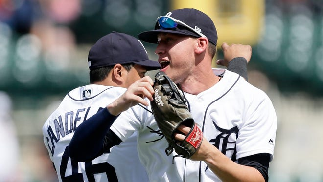 JaCoby Jones of the Tigers celebrates with Jeimer Candelario after a 3-1 win over the Minnesota Twins.