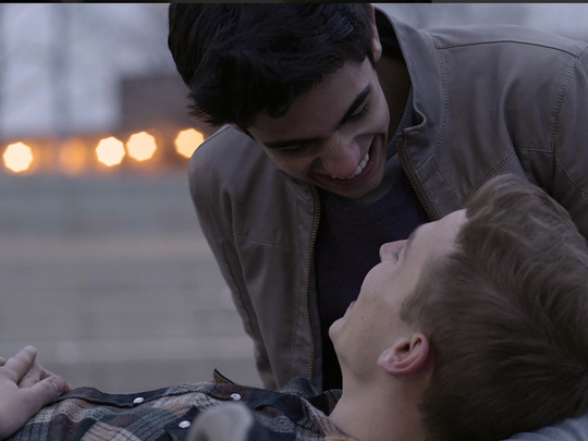 """Benny and Christopher fall in love after meeting at a football game while attending college in """"Akron."""""""
