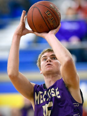 Melrose's Tyler Braegelman puts the ball in from outside the key to score against Watertown-Mayer during the second half of the Christmas Classic Basketball Tournament Monday, Dec. 28, at Cathedral High School.