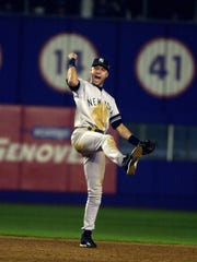 Derek Jeter reacts after the last out of the ninth