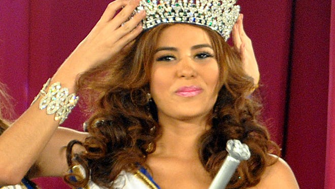 In this April 26, 2014 photo, Maria Jose Alvarado is crowned the new Miss Honduras in San Pedro, Sula, Honduras.