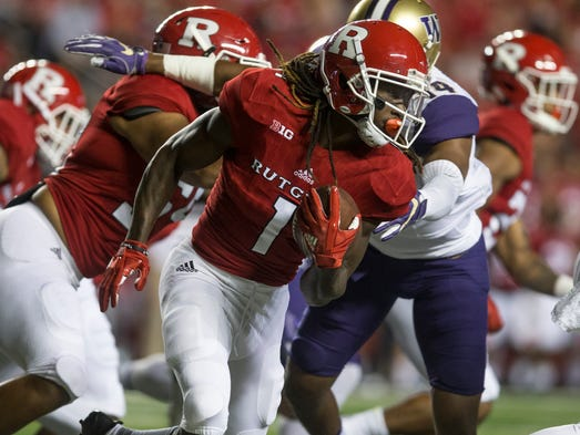 Janarion Grant gains yards. Washington Huskies vs Rutgers