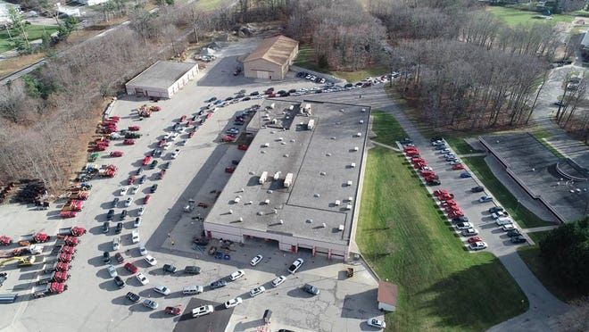 Cars line up while people wait for COVID-19 tests at the Ottawa County Road Commission in Grand Haven, Mich. on Tuesday, Nov. 17.