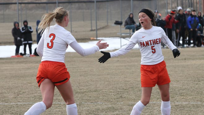 Plymouth's Katie Pocian (3) and Sydney Robinson (5) celebrate a goal against Kettle Moraine Lutheran last Tuesday at Plymouth.
