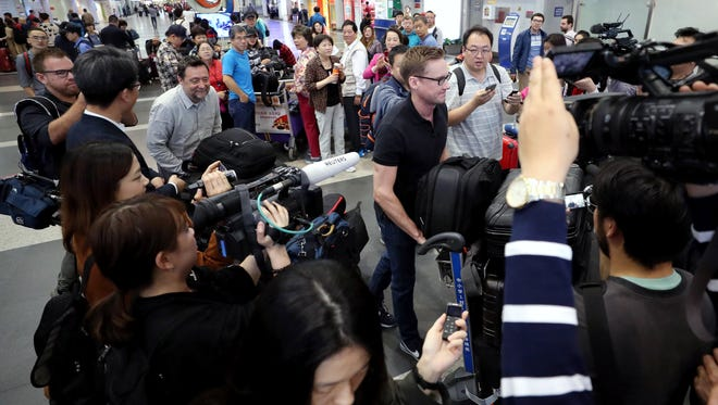 Foreign correspondents invited by North Korea to cover its nuclear site dismantling event depart from a Beijing airport, China, on May 22, 2018.