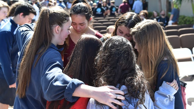 Hundreds gather at Parkridge Church in Coral Springs on Thursday, Feb. 16, 2018, for community prayer vigil for Marjory Stoneman Douglas High School shooting victims.