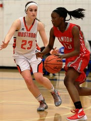 Canton's Shamya Butler (right) dribbles against Northville defender Linsey Rathsburg in Friday's Class A district final.