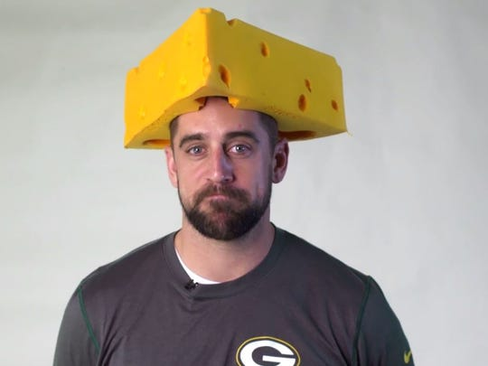 Green Bay Packers quarterback Aaron Rodgers dons a Cheesehead to help raise money for Enough's Raise Hope for Congo campaign.