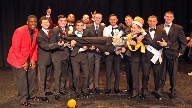 Mr. CRHS 2016 contestants (from left) Tarrell Clark, Brinn Hindermyer, Noah Athey, Isaiah Thomas, Robert Erianne, Chase Roork, Killian Sloan, Tyler Kott, Tyler Vit, Fan Favorite Nikolas Newmaster and Devon Turin celebrate with Mr. CRHS 2016 Seth Davis.