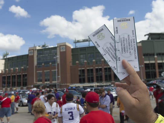 A LSU fan tires to sell tickets  before the Sept. 3