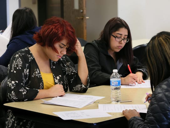 Alex Hernandez (left) and Leslie Moreno, take an exam