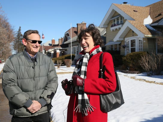 Jon Goldberg Hiller (left) and former Milwaukee Journal Sentinel publisher Betsy Brenner chat in the area of N. 46th St. and W. Wright St. near the home in which their birth mother lived while growing up. Brenner was adopted and raised by a family in Washington.