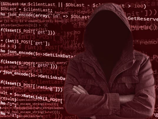 Hacker without face surrounded by programming code