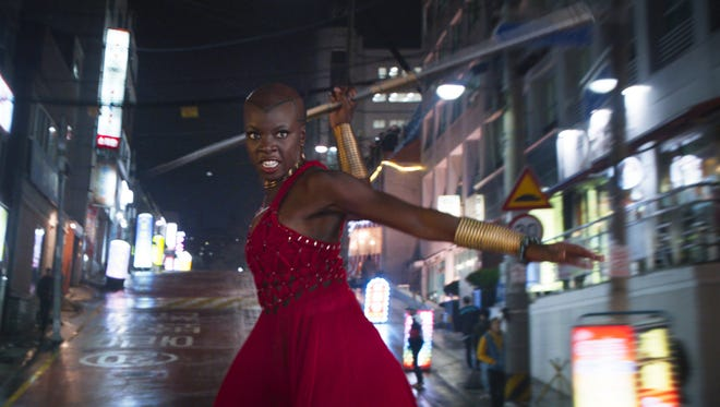 "This image released by Disney shows Danai Gurira in a scene from Marvel Studios' ""Black Panther.""  Gurira says the representation of women in ""Black Panther"" is important for young girls to see. The film features a number of powerful female leads, including Gurira as the head of a special forces unit, Lupita Nyong'o as a spy, Angela Bassett as the Queen Mother and newcomer Letitia Wright as a scientist and inventor."