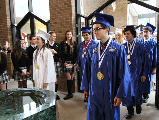 Toms River, NJ -        Students file in to the 2014 Monsignor Donovan High School Graduation Mass and Commencement at the St. Joseph's Roman Catholic Church.