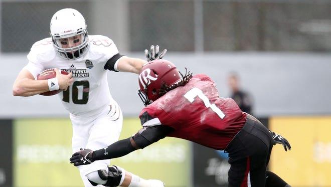 Northwest Missouri State Bearcats quarterback Brady Bolles pushes off Lenoir-Rhyne Bears defensive back Myer Nolan at Braly Municipal Stadium.