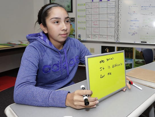 Sadie Kelley holds up her answer during an Oneida language