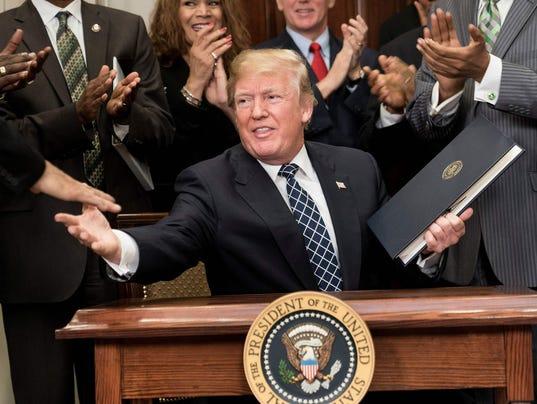 TOPSHOT-US-POLITICS-TRUMP-MLK