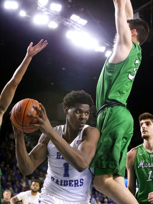 MTSU's Brandon Walters (1) goes up for a shot as Marshall's Jannon Williams (3) defends him on Saturday, March 3, 2018, at MTSU.