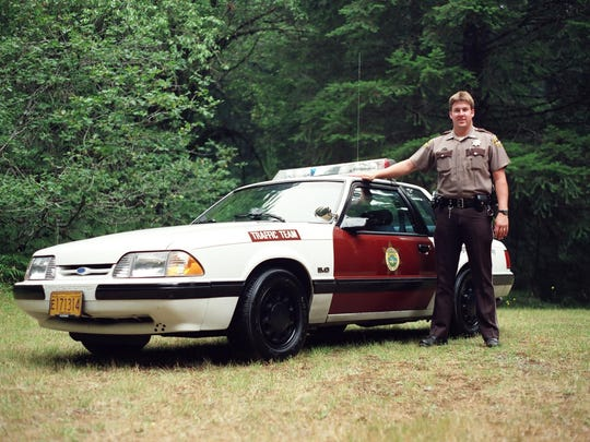 Lt. Tim Steele stands beside his patrol car while he was working for the traffic team.