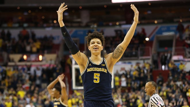 Michigan Wolverines forward D.J. Wilson celebrates in the closing seconds of a victory over the Wisconsin Badgers last March.