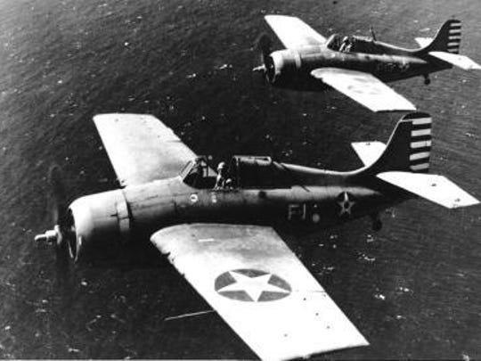Grumman F4F-3 Wildcat fighters, of Fighting Squadron Three (VF-3) in flight near Naval Air Station, Kaneohe, Oahu, Hawaii, 10 April 1942.
