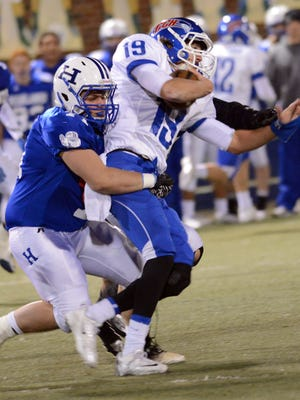 Covington Catholic senior quarterback Adam Wagner is sacked during last season's 28-13 loss to Highlands in the playoffs. The Colonels have lost 11 straight games to the rival Bluebirds – a streak dating back to 2006, when Wagner was a fourth-grader.