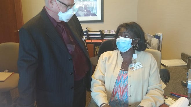 Centerpoint Medical Center Chaplain Howard McFarland visits with Victoria Boswell, the unit secretary of the Same-Day Surgery Center at the hospital, as he makes his daily rounds.