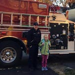 Nice ride: coloring contest winners get ride to school on fire engine
