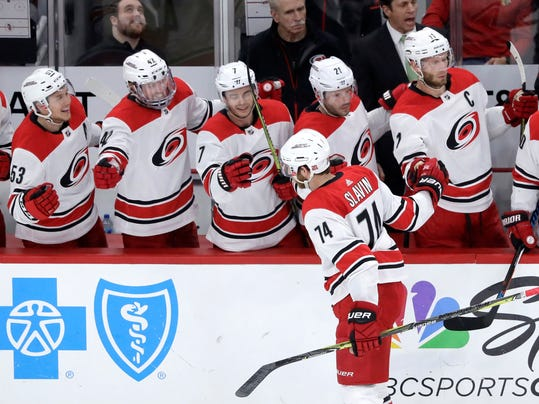 Carolina Hurricanes' Jaccob Slavin (74) celebrates his goal with teammates during the first period of an NHL hockey game against the Chicago Blackhawks, Thursday, March 8, 2018, in Chicago. (AP Photo/Charles Rex Arbogast)