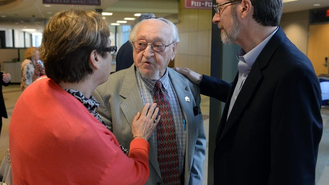 Dr. Rabbi Murray Kohn (center) was honored for his 26 years of service and leadership in Holocaust and Jewish Studies at the celebratory reception at Stockton University on Monday night.