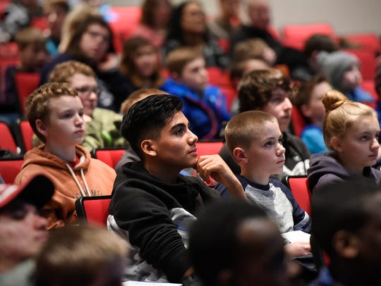 Students watch NASA astronauts Mark Vande Hei and Scott