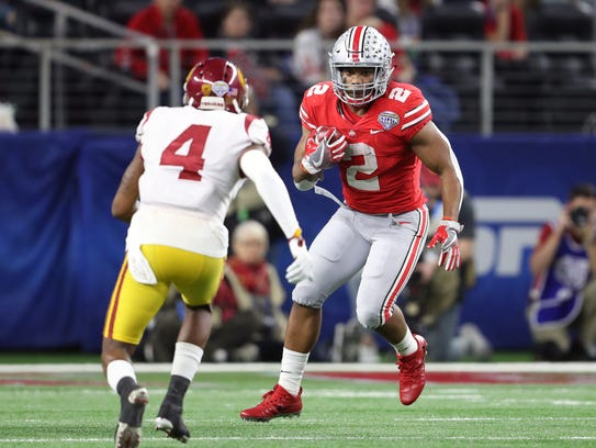 J.K. Dobbins broke the freshman rushing record for