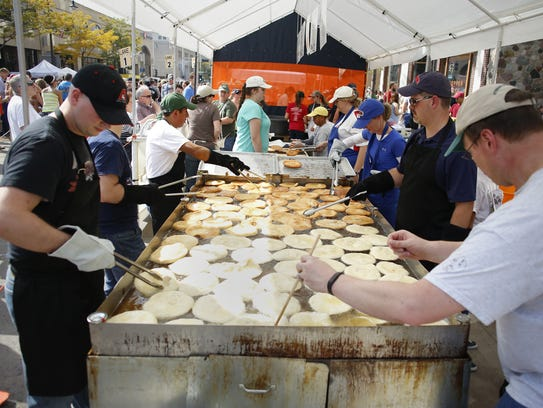 Crews cook up Tiger Paws during Octoberfest 2014 in