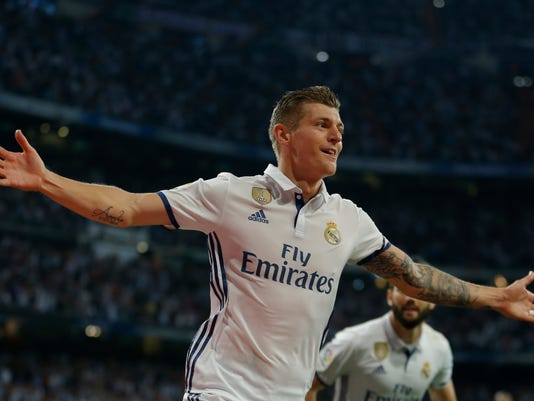 FILE - In this May 14, 2017 file photo, Real Madrid's Toni Kroos celebrates after scoring his side's fourth goal against Sevilla during the La Liga soccer match at the Santiago Bernabeu stadium in Madrid, Spain. Midfielder Kroos  maintained his excellent form for yet another season, he was solid with his marking and precise as ever with his passes, constantly setting up his teammates. Real Madrid meet Juventus in the Champions League final in Cardiff on Saturday June 3, 2017. (AP Photo/Francisco Seco)