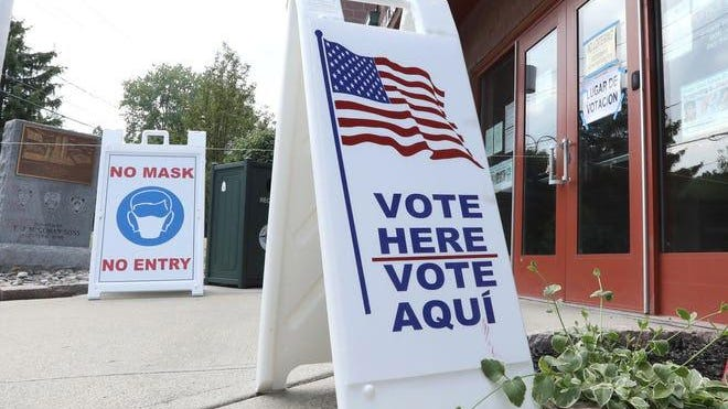 """A """"vote here"""" sign at the West Haverstraw Community Center June 23, 2020."""