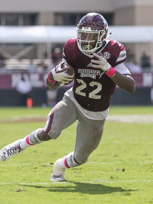 Mississippi State's Aeris Williams (22) looks for running room during the game against BYU.